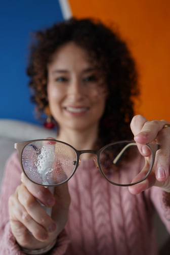 Optician Cleaning Eyeglass Lenses